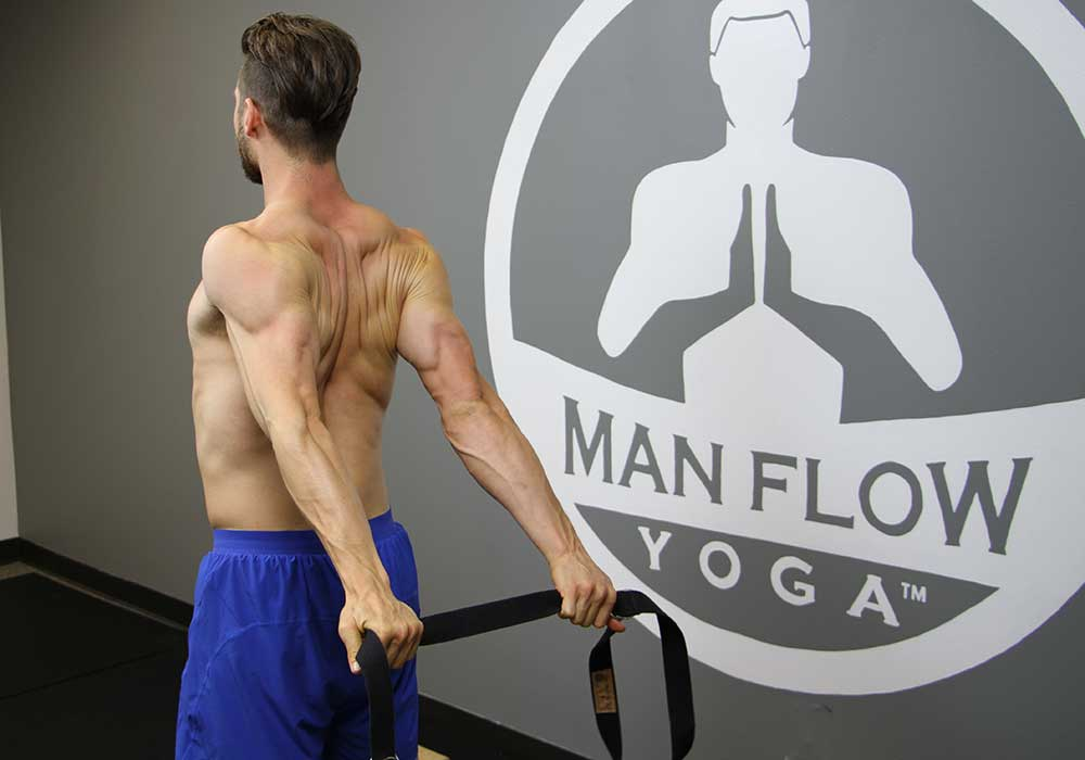 simple strap behind the back stretch for stronger chest muscles